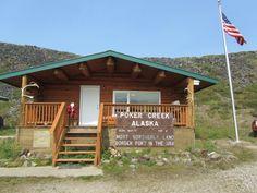 Canadian / American border located: Top of the World Highway, Yukon Territory    copyrighted 2014 Dark Woods Studios, Ltd. Co. dwoodstudio.com