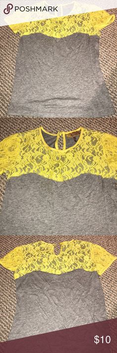 Laced t-shirt Beautiful laced detailed on the top of the shirt. Grey party is comfy t-shirt material Tops Tees - Short Sleeve
