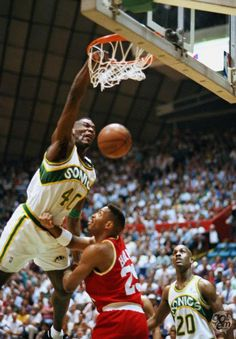 Shawn Kemp was a famous basketball player for the Seattle Supersonics that was infamous for his monstrous dunks that rocked the rim. Basketball Legends, Basketball Players, Basketball Art, Basketball Season, College Basketball, Sports Teams, Slam Dunk, Sports Images, Sports Pictures
