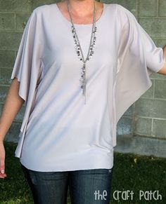 Circle Shirt Tutorial.  Knit fabric rounded at the corners, front + back neck cut, then sew up two sides.  Easy as.