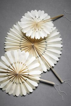 centerpieces, decor hung from the ceiling, or wouldn't they make great fans for a garden party???