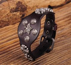 "- Material: Genuine Leather - Length: adjustable from 7"" - 8.5"" - Band Width: 1.18"" - Metal: Copper Alloy - Clasp Type: Easy-Hook"