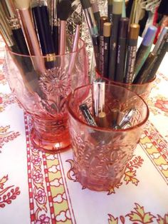 I totally love the idea of toothbrush holders/fancy cups to hold your makeup brushes/makeup