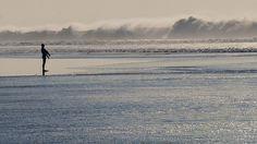 Carcavelos beach - he beach hosts surfers all year round.