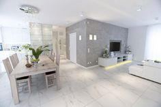 Sober, Yet Positive: White Apartment in Warsaw by Chalupko Design [Video]