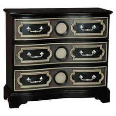 """A timeless addition to your living room or master suite, this handsome chest showcases 3 drawers and stylish raised moldings. Product: Chest Construction Material: Wood and metalColor: Black, steel gray and cream Features: Raised moldings Three lined drawers Bracket feet Decorative drawer overlay Dimensions: 39.75"""" H x 43.5"""" W x 19"""" D"""