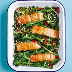 Oven-roasted salmon with oregano, lemon and tender veges - Healthy Food Guide Salmon Recipes, Fish Recipes, Healthy Recipes, Healthy Food, Oven Roasted Salmon, Tray Bake Recipes, Cake Recipes, Roasting Tins, Stuffed Peppers