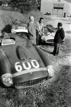Enzo Ferrari and some factory racers.