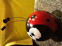Ladybugs yard art bowling ball