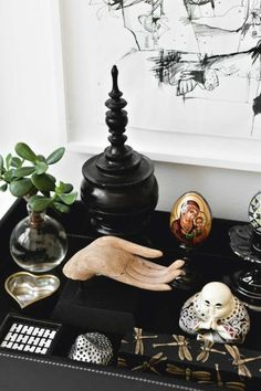 A lovely balance of sacred objects, placed with care create a personal and meaningful home alar.
