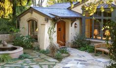 great feel  Spanish colonial or Mediterranean feel court home.....great window