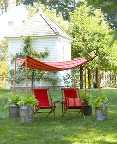 Good Housekeeping - outdoor canopy made with old milk jug cans  I'd never find the cans or be willing to pay lots for them, but I wonder if I can disguise empty buckets (the big kind painters, sheetroc folks use) instead.  I could even sink them, totally or partially.