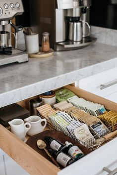 The tea Drawer Inside the tea drawer, I store individual tea packets in a wire utensil tray. A shallow wood bowl found in France is used to keep the stevia bottles from rolling around, and a few small ironstone creamers are easy to grab when setting a bre Coffee Station Kitchen, Coffee Bar Home, Home Coffee Stations, Coffe Bar, Coffee Corner Kitchen, Coffee Bar Station, Coffee Bar Design, Coffee Tray, Coffee Room