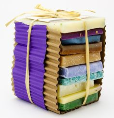 10 Two-ounce soap bars neatly packaged with natural raffia and a card that lists scents. Scents vary.