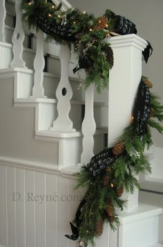 Banister decorated with script ribbon and greens by d reyne's: Decorating for the Season...Christmas is here!