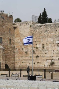 Israeli Flag in front of the Western Wall in the Old City of Jerusalem. Abandoned Castles, Abandoned Mansions, Abandoned Places, Israeli Flag, Most Haunted Places, Western Wall, Abandoned Amusement Parks, Israel Travel, Holy Land