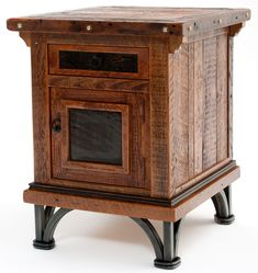 Hand forged metal base is combined with naturally aged distressed wood to form a unique western style end table or nightstand perfect for Spanish, cabin, lodge