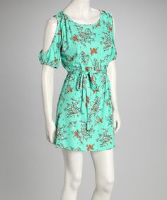 Decorated with a dainty floral print, this minty dress boasts the perfect blend of femininity and trendiness. Cutouts along the sleeves and a belted waist take the stylishness up a notch. Measurements (size S): 34'' long from high point of shoulder to hem95% polyester / 5% spandexMachine wash; tumble dry