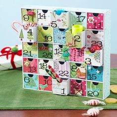Convert a small craft organizer box into this Advent calendar. Just cover each box with a different piece of patterned scrapbooking paper and number them 1-25. Place them back into the box in random order, and then fill each draw with fun treats.