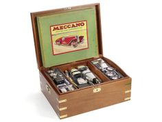 A boxed silver Meccano motor car constructor kit together with the original Meccano kit for the same vehicle the silver model with maker's mark for Garrard & Co Ltd, London 1995.