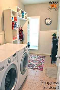 """A great reveal but what is catching my eye is the """"partial"""" black cabinet attached to the wall. Great idea for a narrow  space.The laundry slash mudroom is almost done."""