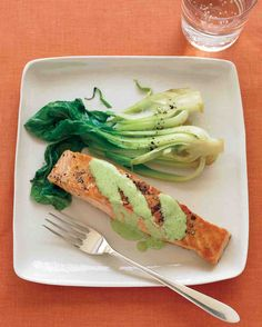 Cilantro, wasabi paste, lime juice, ginger, and light mayonnaise combine to make a delightful sauce for pan-seared salmon fillets. Serve with bok choy sauteed in mirin and soy sauce.