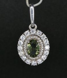 Boho Jewelry Model Moldavite Faceted With Small Cubic Zirconia 925 Sterling Silver Pendant. Boho Jewelry Model Moldavite Faceted With Small Cubic Zirconia 925 Sterling Silver Pendant Jewelry Model, Boho Jewelry, Jewelry Gifts, Fashion Jewelry, Pendant Jewelry, Jewellery, Swarovski Stones, Sterling Silver Pendants, Healing Crystals