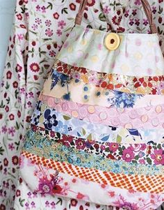 """For a simple tote, cut about 10 yard-long strips of floral fabric in varying widths. Sew the strips together to make one large piece of fabric. Fold """"fabric"""" in half, trim to desired shape, stitch sides and hem top, then finish with a large vintage button and a premade wicker handle from a crafts store."""