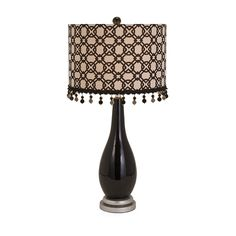 Aneeta Ceramic Table Lamp - Decorating is such a tassel: Becky Fletcher designs a ceramic lamp with an iron base and a linen shade embellished with swingy beaded tassels.