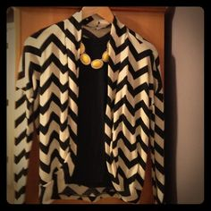 Chevron Shrug Black and cream chevron shrug.  Necklace and T-shirt not included.  Gently used. Charlotte Russe Sweaters Shrugs & Ponchos