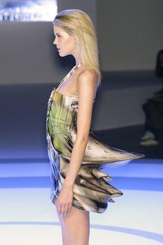 Futuristic Fashion - dress with fluid contours; 3D tail detail; sculptural, space-age style // Hussein Chalayan
