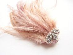 a peach feather fascinator :) love