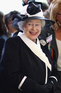 Queen Elizabeth II laughs as she watches children play a game at Devlin Castle Hotel on the first day of a tour of Slovakia on October 2008 in Bratislava, Slovakia. The Queen and the Duke are on. Get premium, high resolution news photos at Getty Images Die Queen, Hm The Queen, Royal Queen, Her Majesty The Queen, Save The Queen, English Royal Family, British Royal Families, Reine Victoria, Queen Victoria