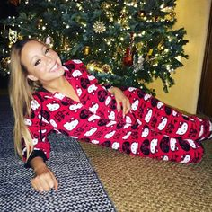 Pin for Later: Nobody Does Christmas Quite Like Mariah Carey  She got in the holiday spirit and wore a Hello Kitty onesie in 2015.