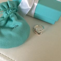 Tiffany& Co. Elsa Peretti Open Heart Ring Authentic Sterling silver size 6.5. Minor scuffs, however not able to get a good picture of them  Hardly noticeable. Comes with box and pouch Tiffany & Co. Jewelry Rings
