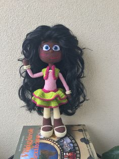This is Szafi and it is a crochet doll with black wig. It's the little girl's favourite. Hands of this doll are moveable plus it has got safety eyes. This doll is made by Nomdolly.