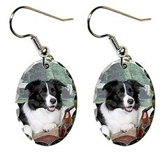"Border Collie Earrings. Super lightweight and small. Ovals measure just 0.875"" x .6"". Made of aluminum with a scalloped edge. The ear wires are silver plated. Packaged in a black, velour covered, jewerly box."