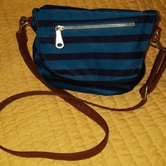 Old Navy Crossbody Striped Navy/dark teal with brown strap and Gold fixtures. Has a zipper compartment on both inside and outside of bag. Old Navy Bags Crossbody Bags