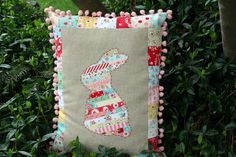 ticker tape bunny pillow by sewdeerlyloved, via Flickr