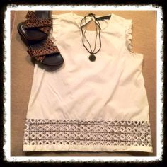 """Zara white ruffle cut out back sleeveless top Zara white ruffle cut out back sleeveless top. Gorgeous Zara top with lattice detail on bottom. Button closure on back above cut out. 100% polyester. Measures 25"""" in length & 17"""" across chest. Excellent condition. Size small. NO TRADESBundle to save 10%!Reasonable offers welcome via offer button Zara Tops"""