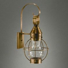 Northeast Lantern Onion 1 Light Outdoor Wall Lantern Finish: Antique Brass, Shade Type: Clear