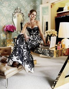 Aerin Lauder in her closet, perched atop a mirrored desk in a showstopping gown.Gown, $11,900, and shoes, $495, Oscar de la Renta. 212-288-5810. Ring, $11,750, David Webb. 212-421-3030.