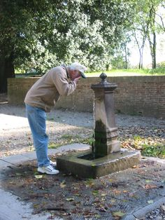 ken getting drink of water along the way around lucca.