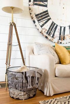 LOVVVVVVVVVVVEE that clock behind the couch!!  OH... I want that!!!  Cute idea for the blankets too - I have mine like this - only in a wicker basket.