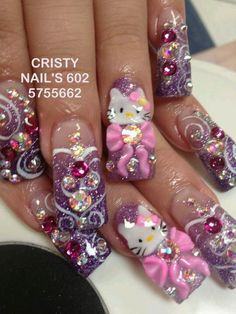 Purple hello Kitty nail