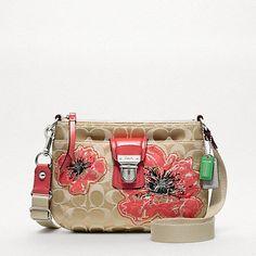 Super cute floral pattern. ;) Coach Poppy Signature Flower Swingpack, starting at $100. - xoxo Matilda