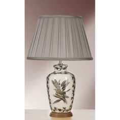 The Etched Birds ginger jar table lamp with brown and grey etched birds on an oriental porcelain base. A traditional design Chinese influenced lamp from the Oriental range that forms part of our Empire Table Lamp Collection. This collection showcases high quality designer lamps that exude style and class. It is the attention to detail that sets these lamps apart and they are held in high regard by interior designers and retailers alike. Traditional Chinese temple jars were used to store a…