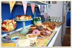 Those donuts look delicious! Can't wait to throw a baby shower with these ideas, love the triangle banner!