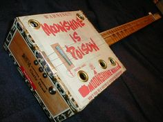 guitar made out of a cigar box Actually this is a Ukelele.