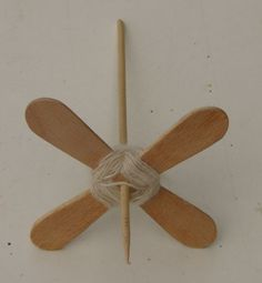 turkish spindle with popsicle sticks. Drill a hole in the center for dowel - can remove sticks for a center pull ball.